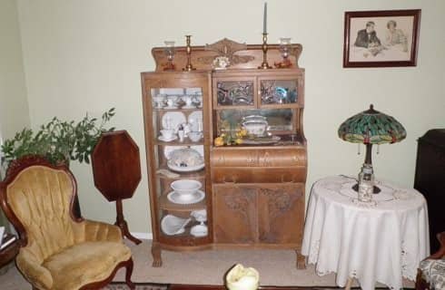 Antique wooden hutch with china