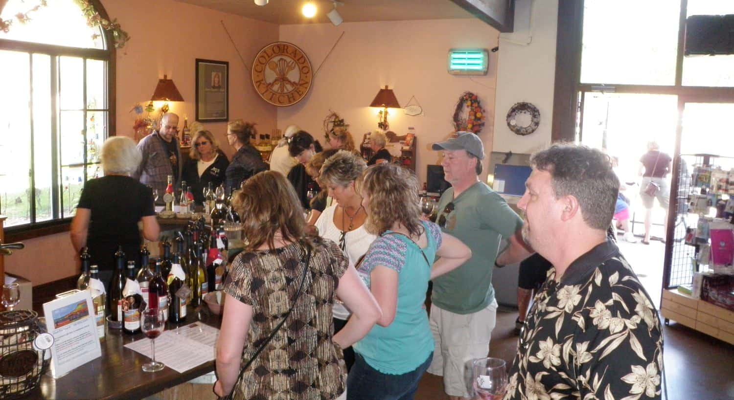 Group of people sampling wine at a wine tasting