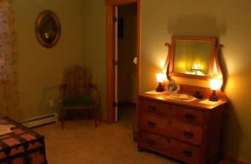 Antique dresser with lamps and a mirror