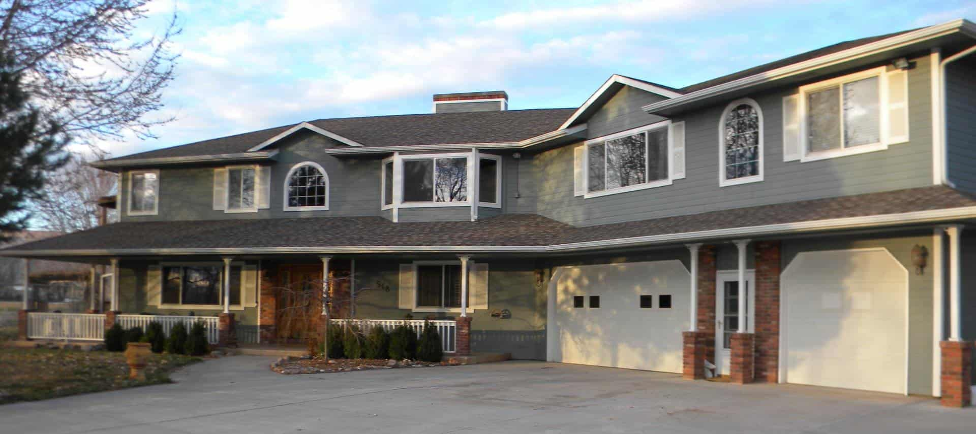 Large house painted gray with white trim