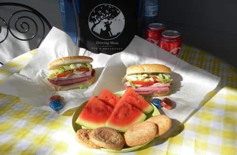 Hoagie sandwiches with cookies and watermelon